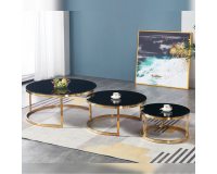 A trio of tables for a living room glass with a titanium gold plating.